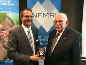 Dr John Dixon Hughes OAM (right) presents inaugural Medical Research Innovation Medal to A/Prof Guillaume Lessene